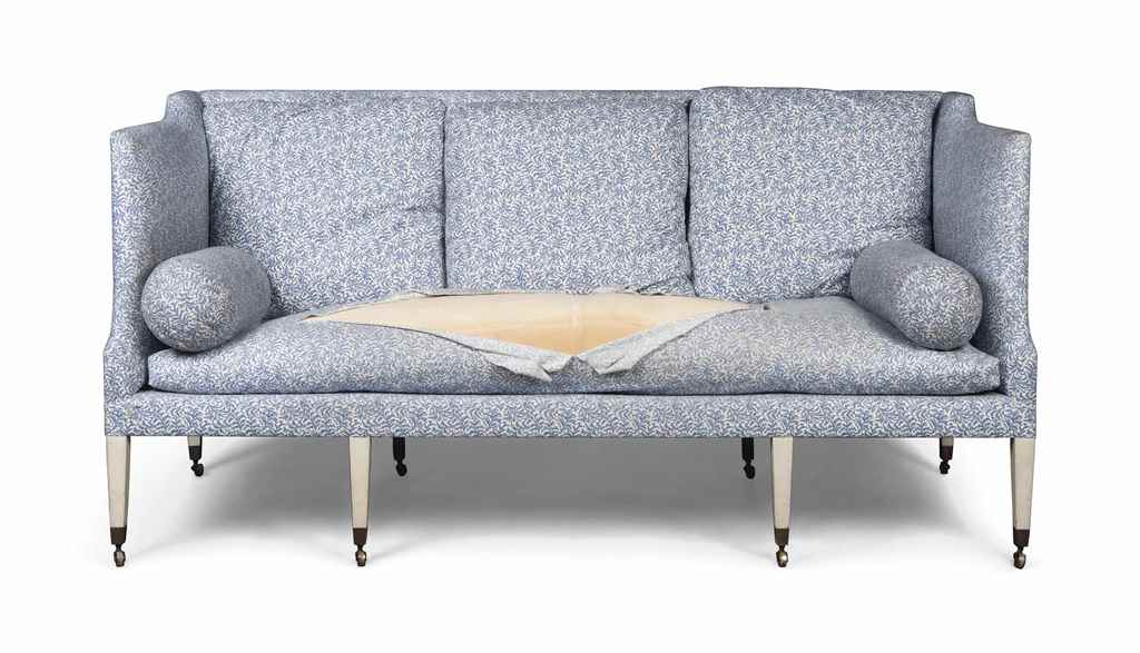 A WHITE-PAINTED SOFA