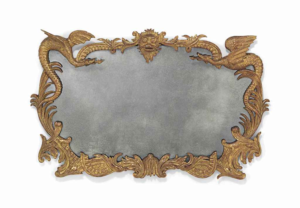 A GILTWOOD CARTOUCHE-SHAPED MI