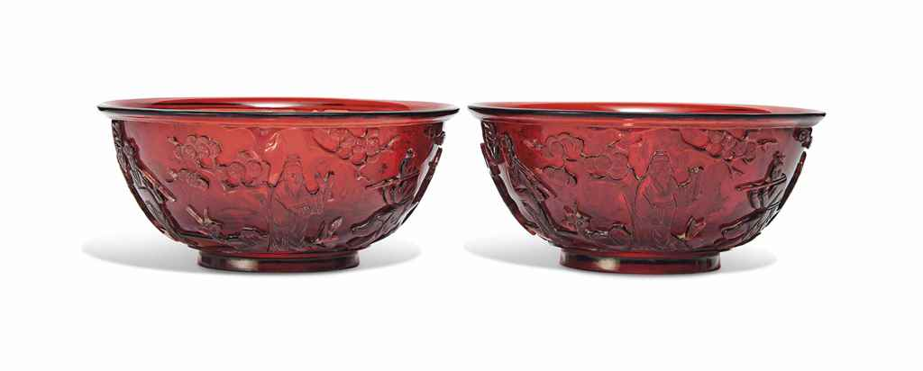 A PAIR OF CHINESE RED GLASS 'I