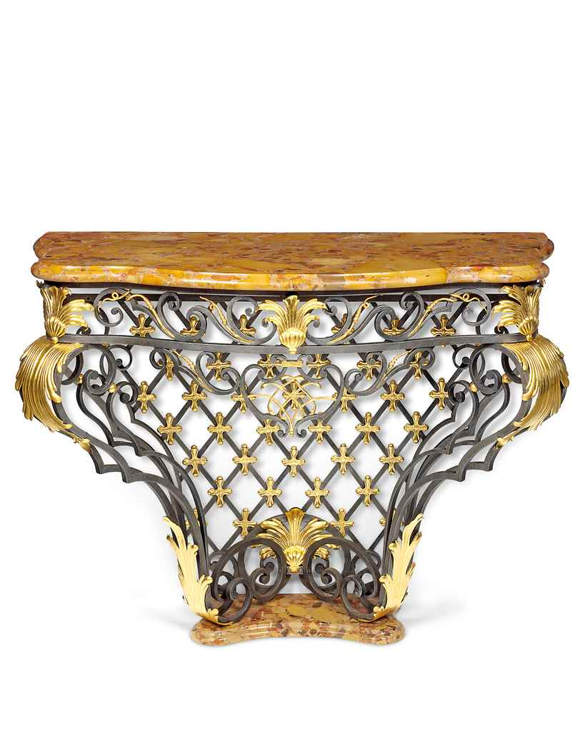 A FRENCH GILT-METAL AND WROUGH