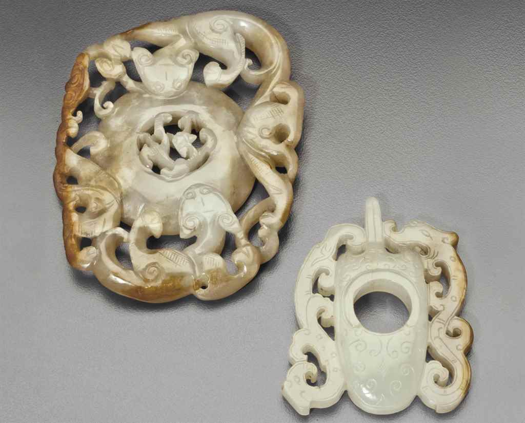 TWO WHITE AND RUSSET JADE ARCHAISTIC PLAQUES