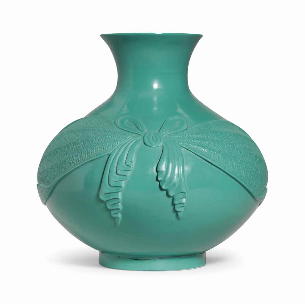 A VERY RARE IMPERIAL OPAQUE TURQUOISE-GREEN GLASS COMPRESSED...