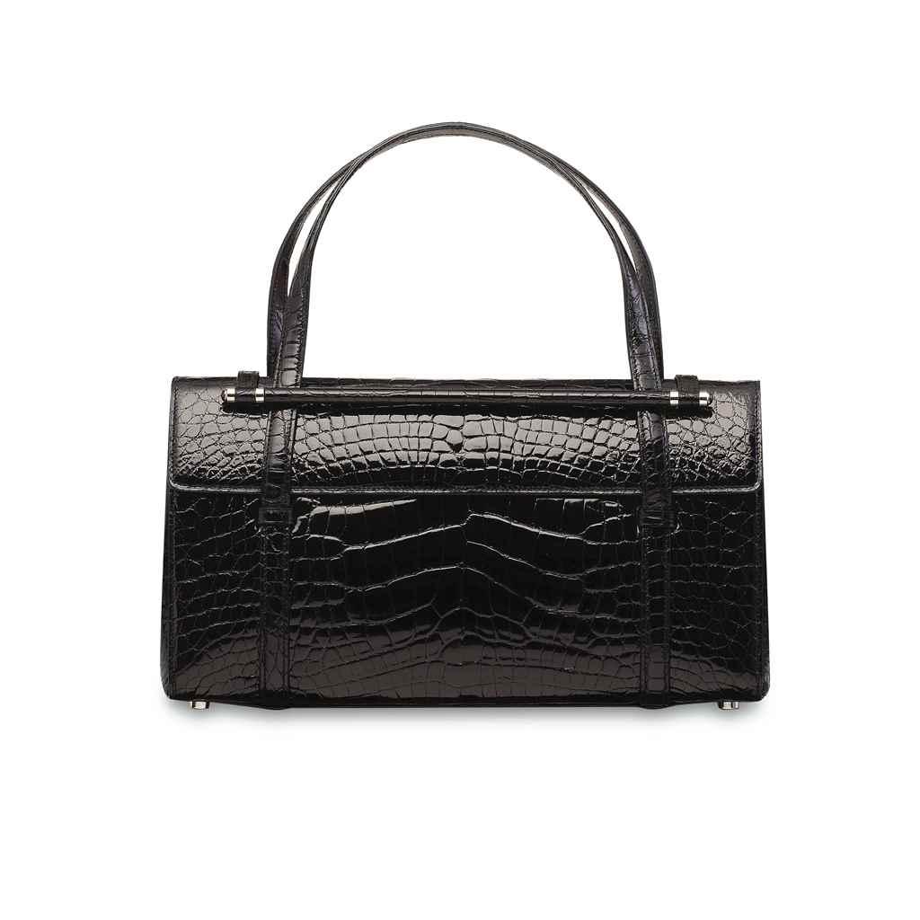 A SHINY BLACK CROCODILE BAG WITH SILVER HARDWARE