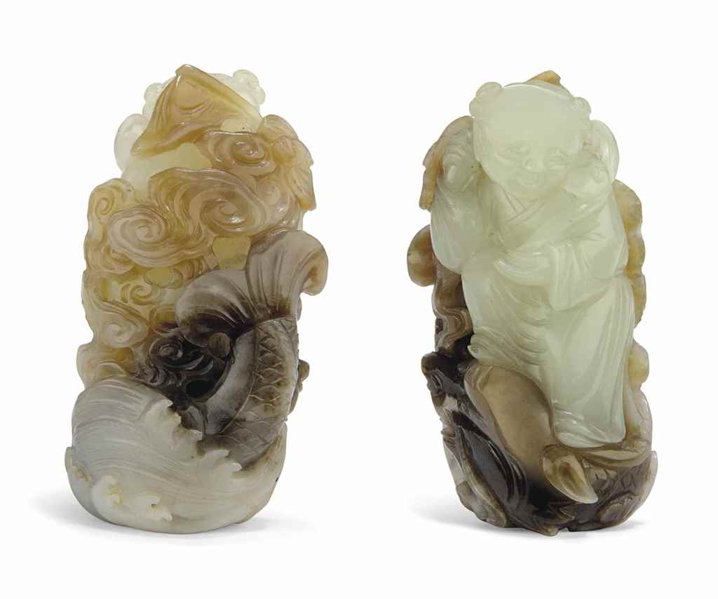 A WHITE AND RUSSET JADE 'BOY AND DRAGON' CARVING
