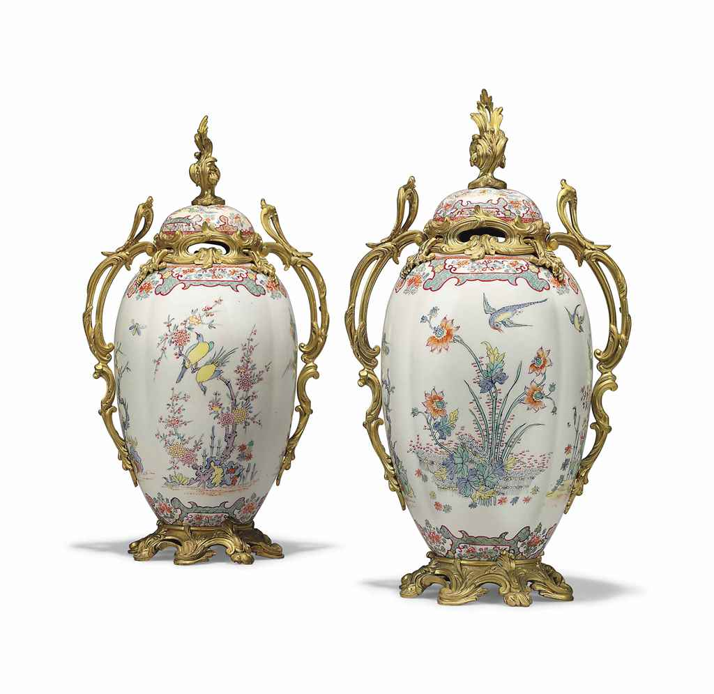 A PAIR OF FRENCH ORMOLU-MOUNTED PORCELAIN LOBED VASES AND