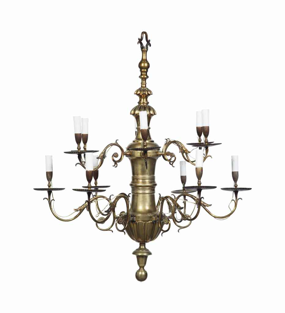 AN ENGLISH BRASS TWELVE BRANCH CHANDELIER OF GEORGE II