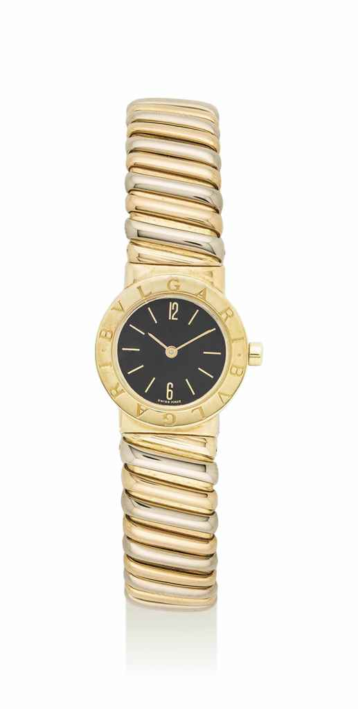 BULGARI. A THREE-COLOR GOLD BA