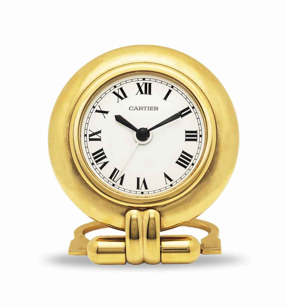 CARTIER. A GILT TRAVEL CLOCK W