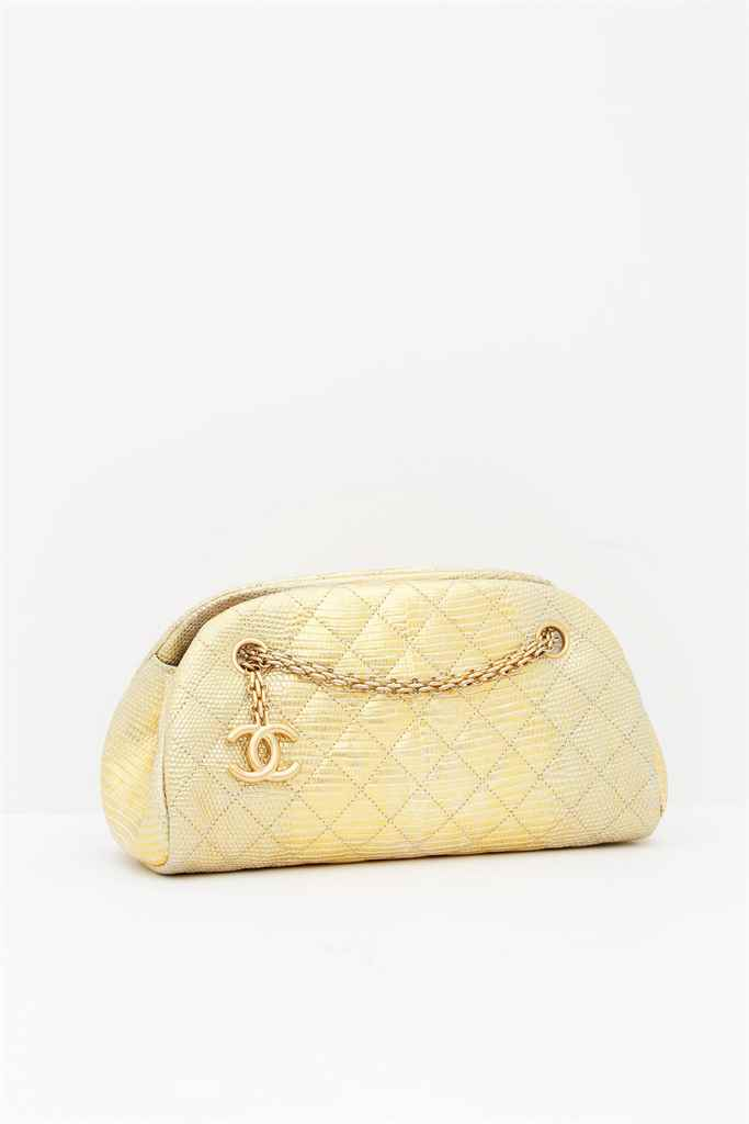 CHANEL. A GOLD LIZARD SMALL MA