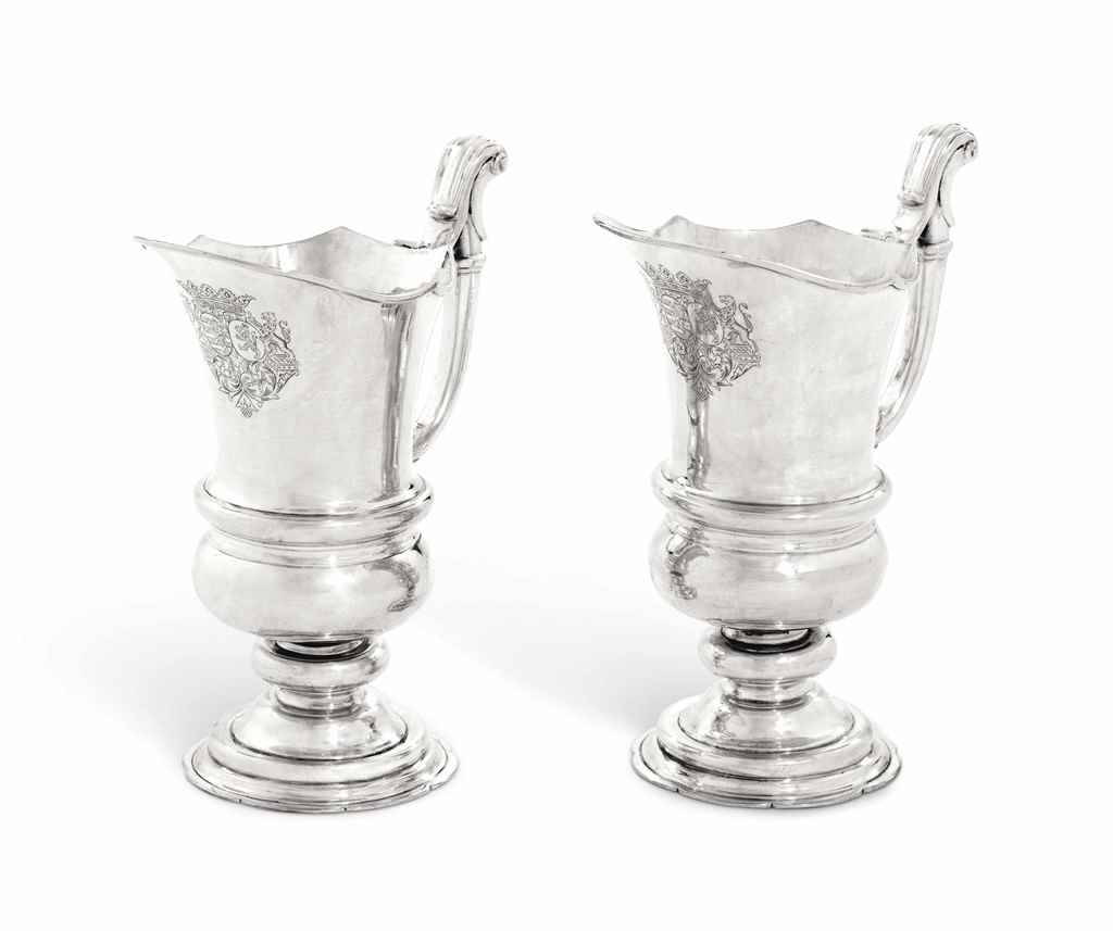 A PAIR OF GERMAN SILVER EWERS