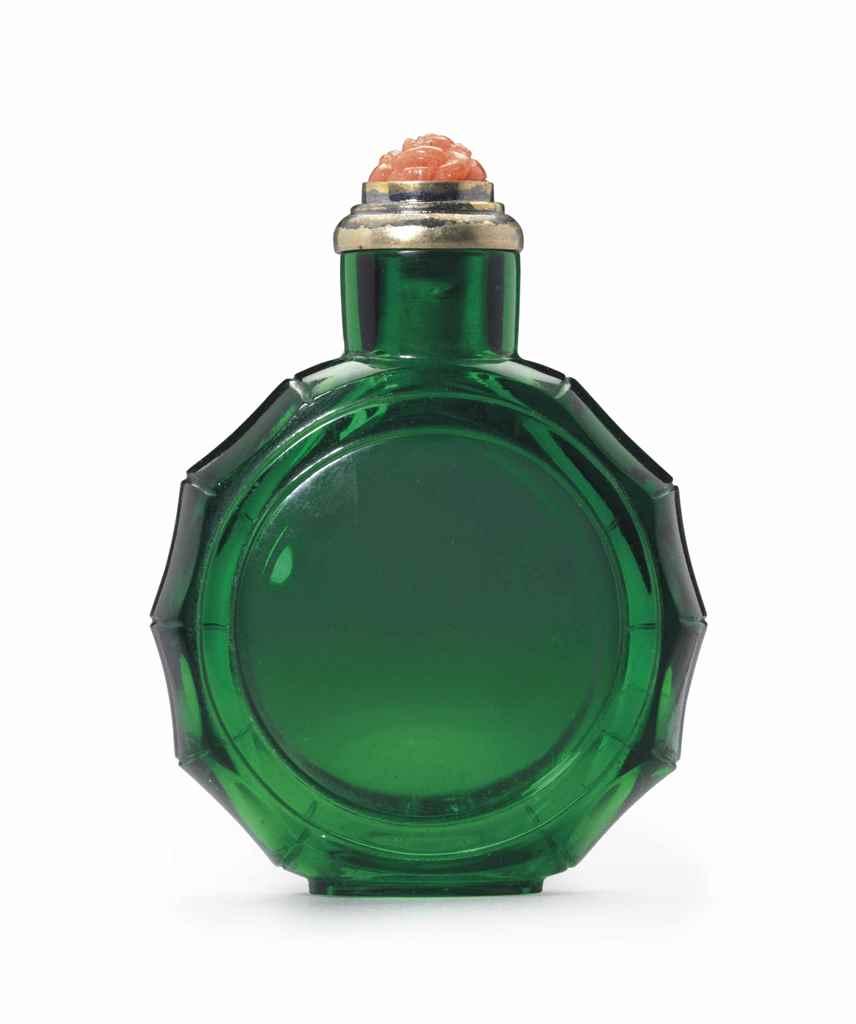 AN EMERALD-GREEN GLASS FACETED