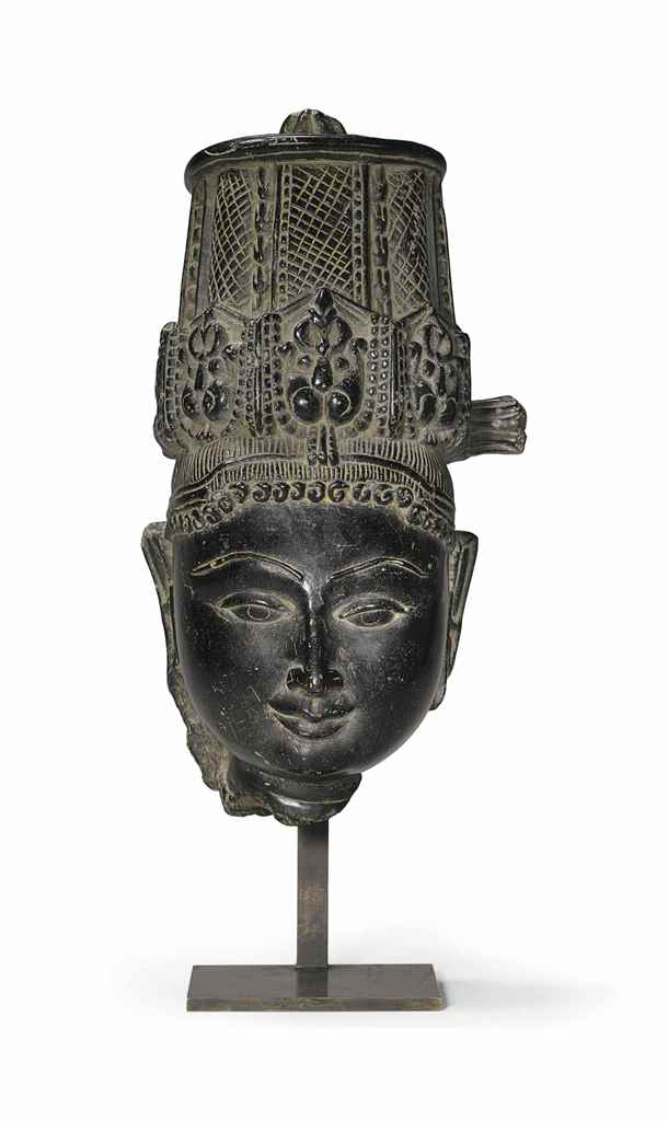 A black stone head of Vishnu