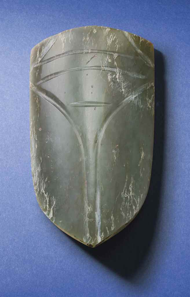 A SMALL DARK OLIVE-GREEN JADE