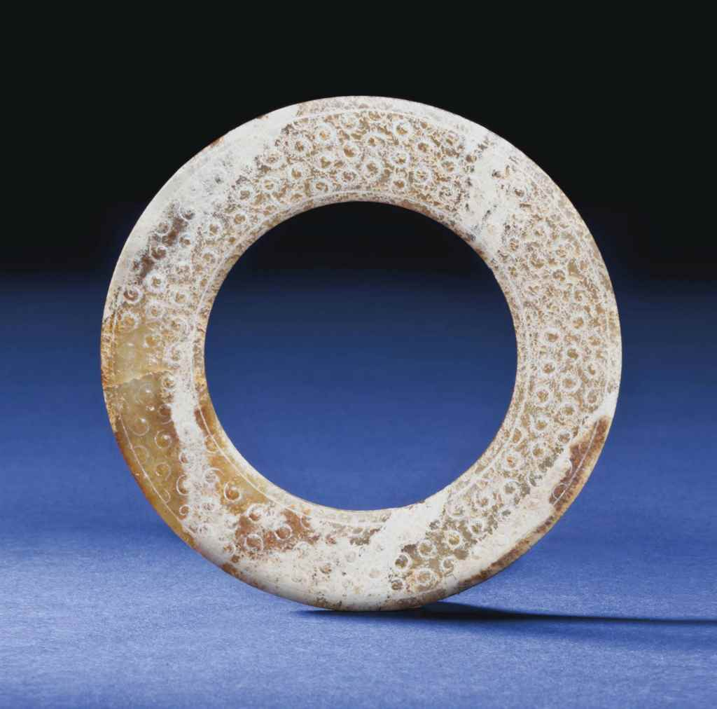 A WELL-CARVED JADE RING, HUAN