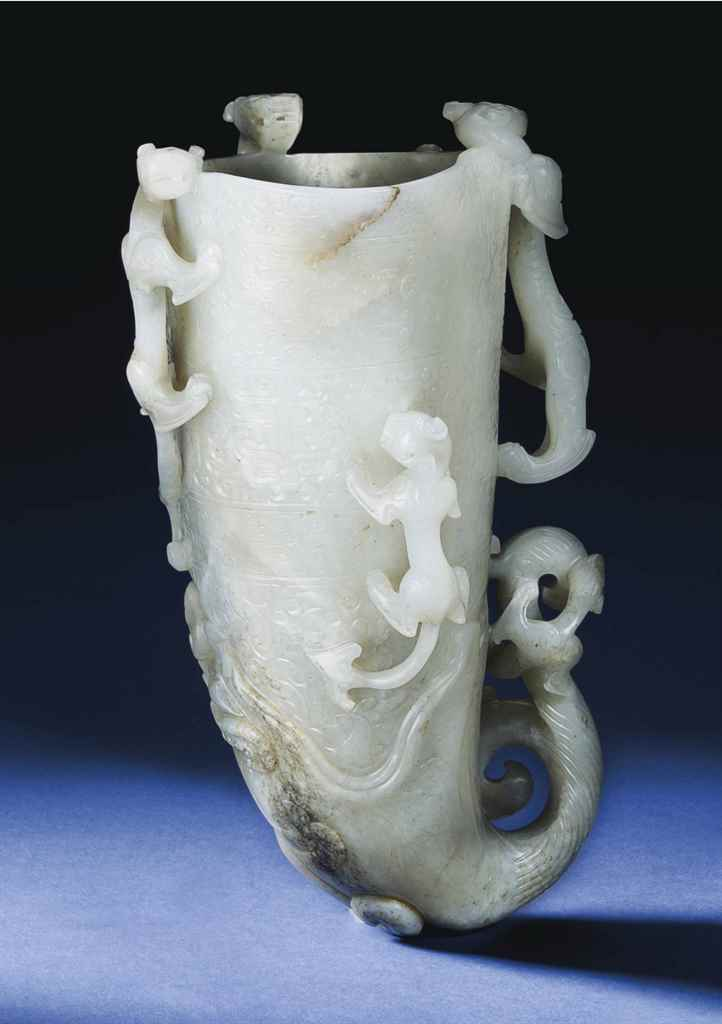 A LARGE WELL-CARVED WHITE AND