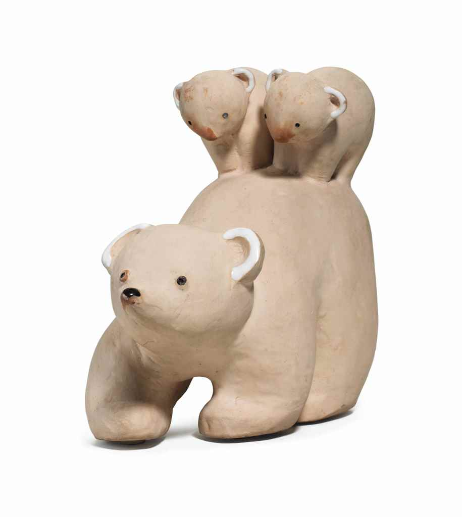 A POTTERY FIGURE OF A BEAR AND