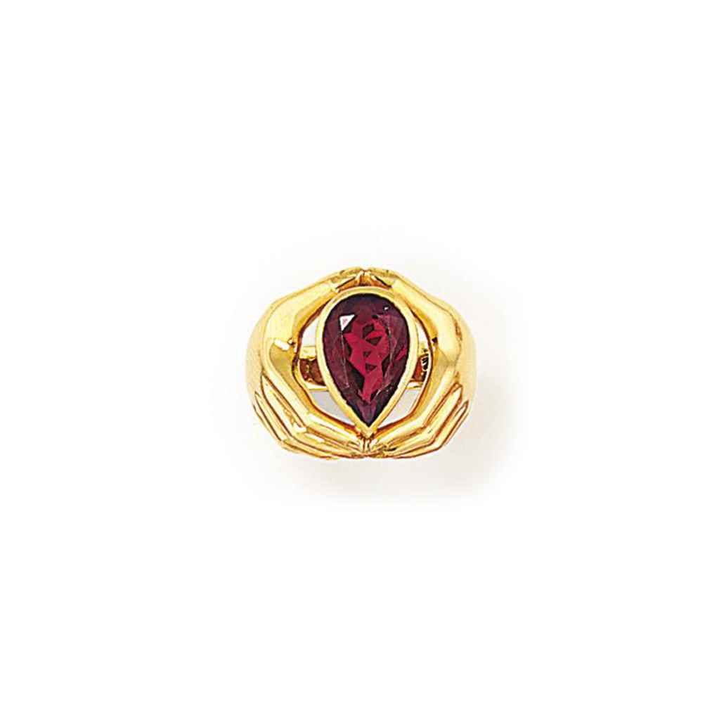 A GARNET SINGLE STONE RING, BY
