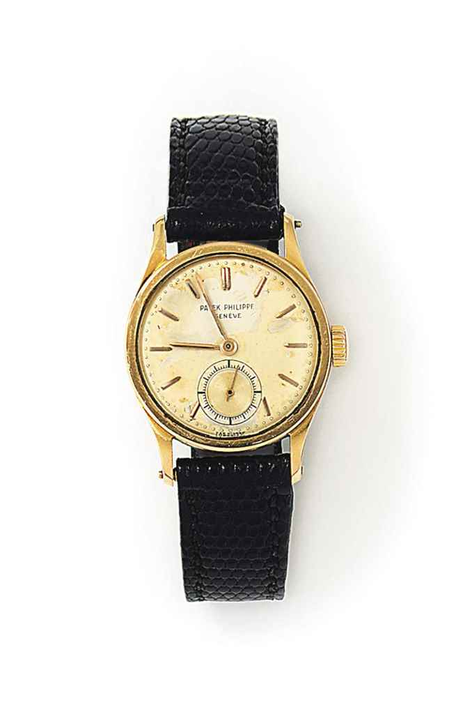 AN 18CT GOLD 'CALATRAVA' WRIST