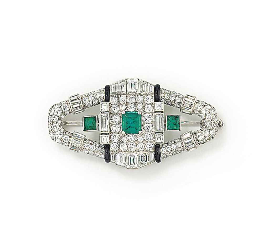 AN ART DECO EMERALD, ENAMEL AN