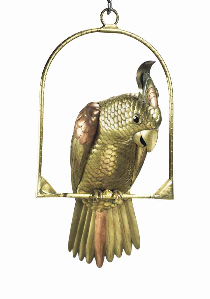 A COPPER AND GILT-METAL PARROT
