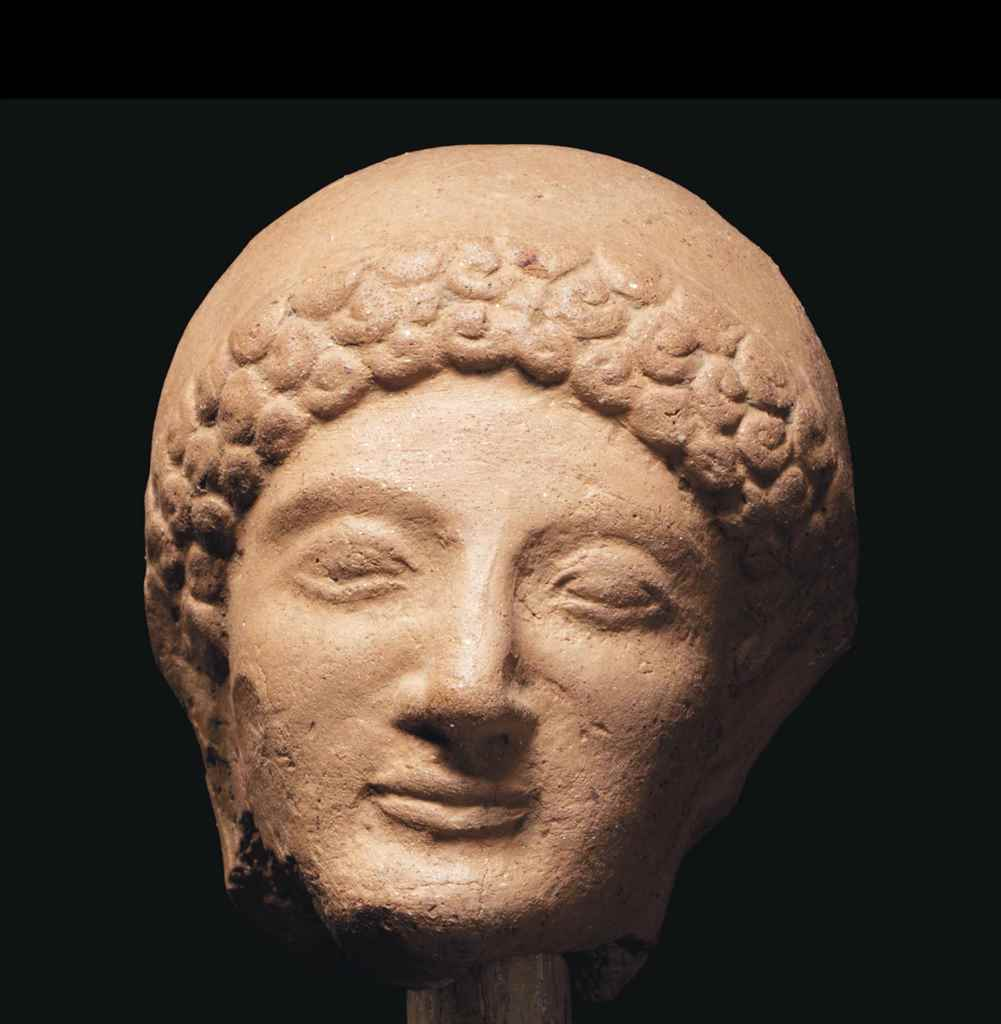 A GREEK TERRACOTTA VOTIVE HEAD