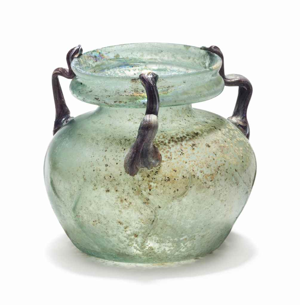 A LATE ROMAN GLASS THREE-HANDL