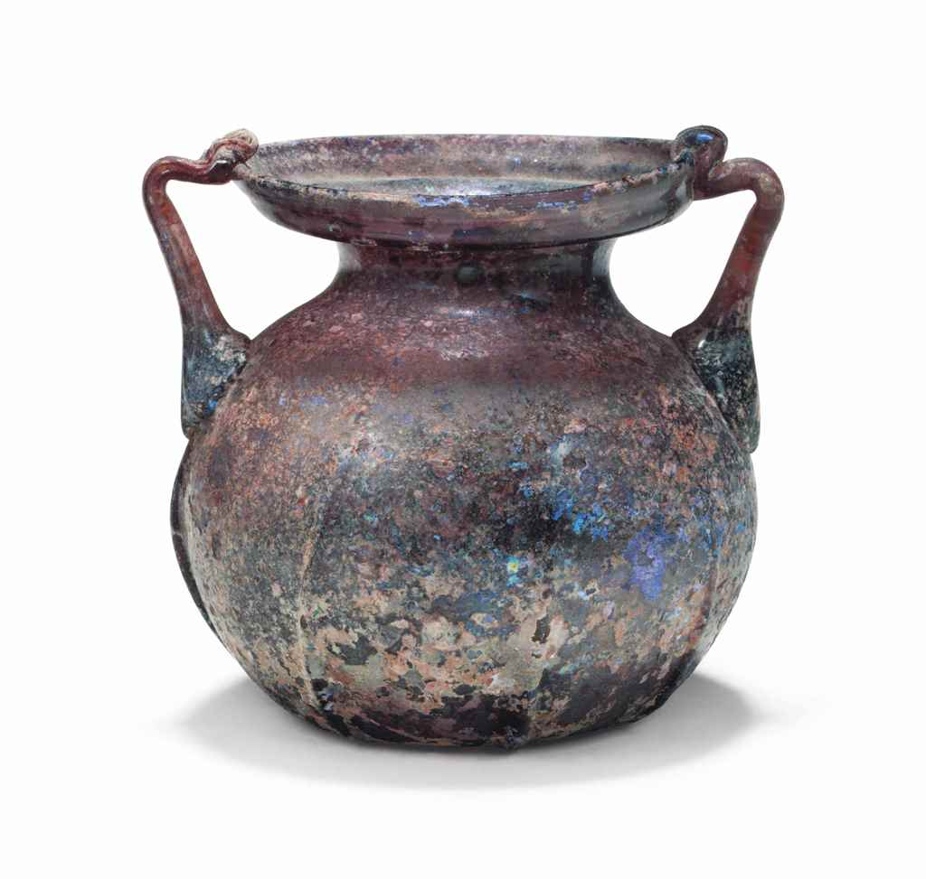 A LATE ROMAN GLASS TWO-HANDLED