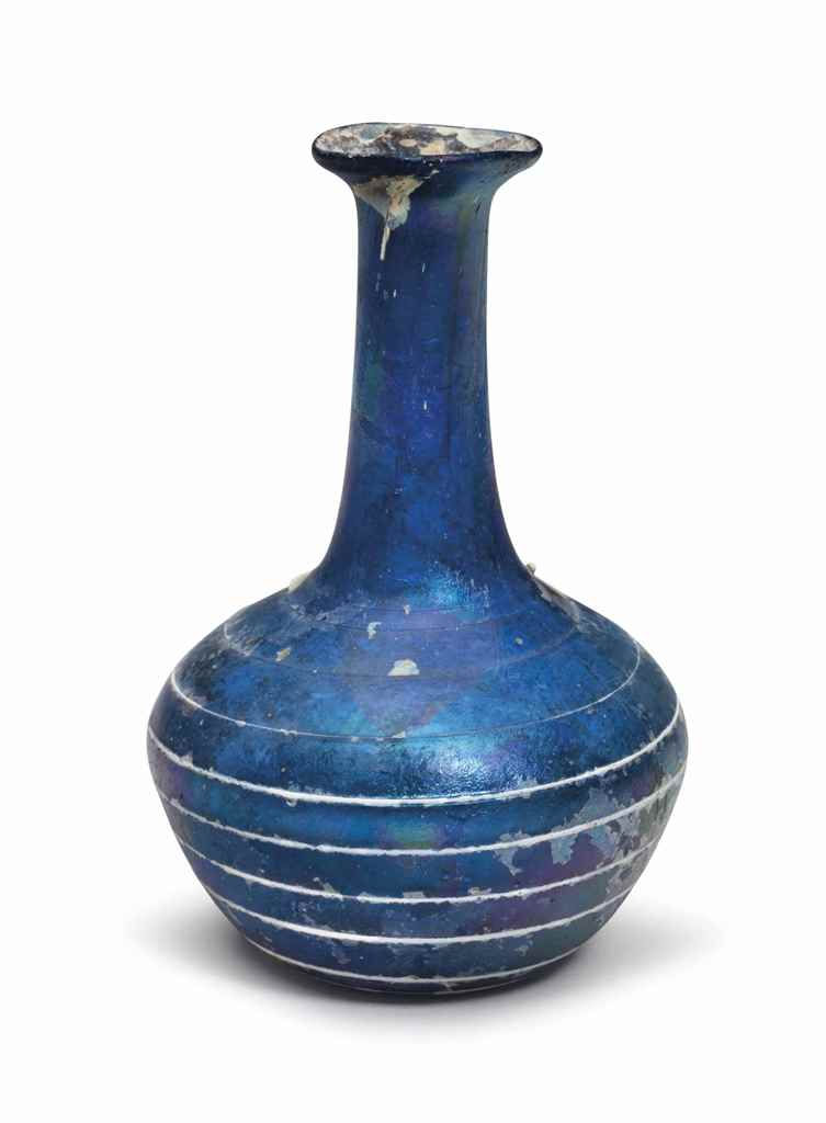 A ROMAN GLASS BOTTLE