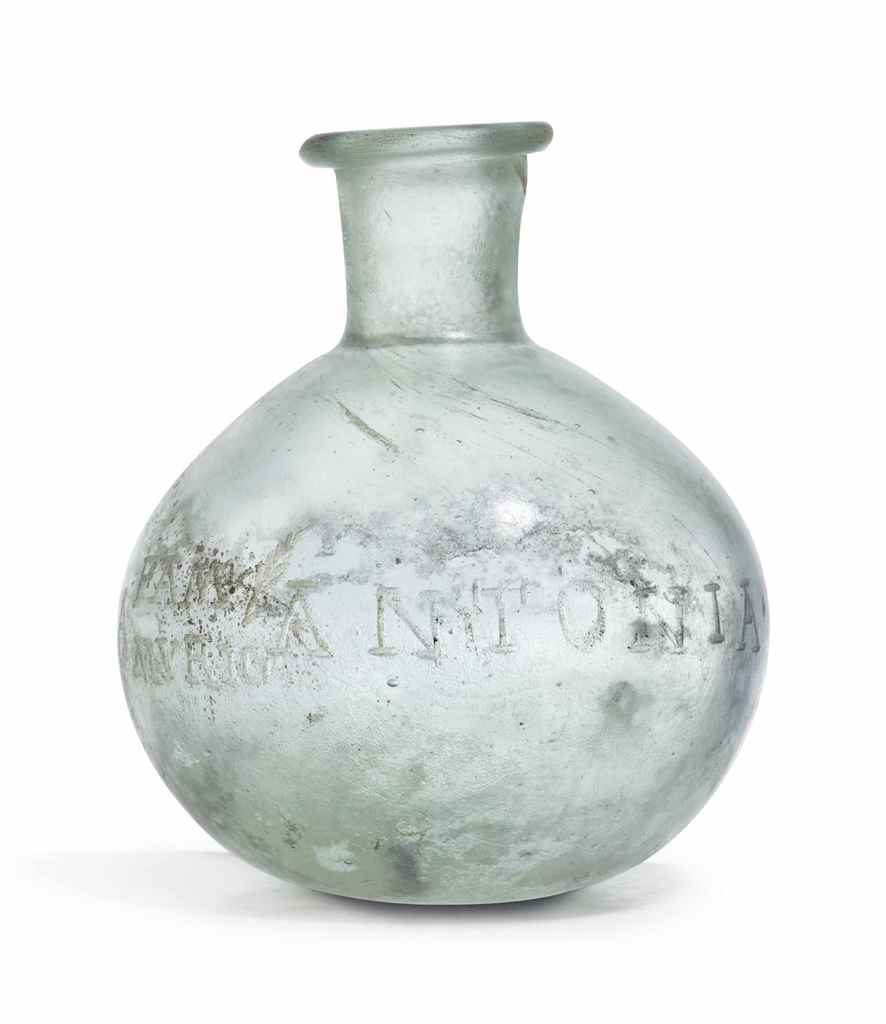 A ROMAN GLASS INSCRIBED BOTTLE