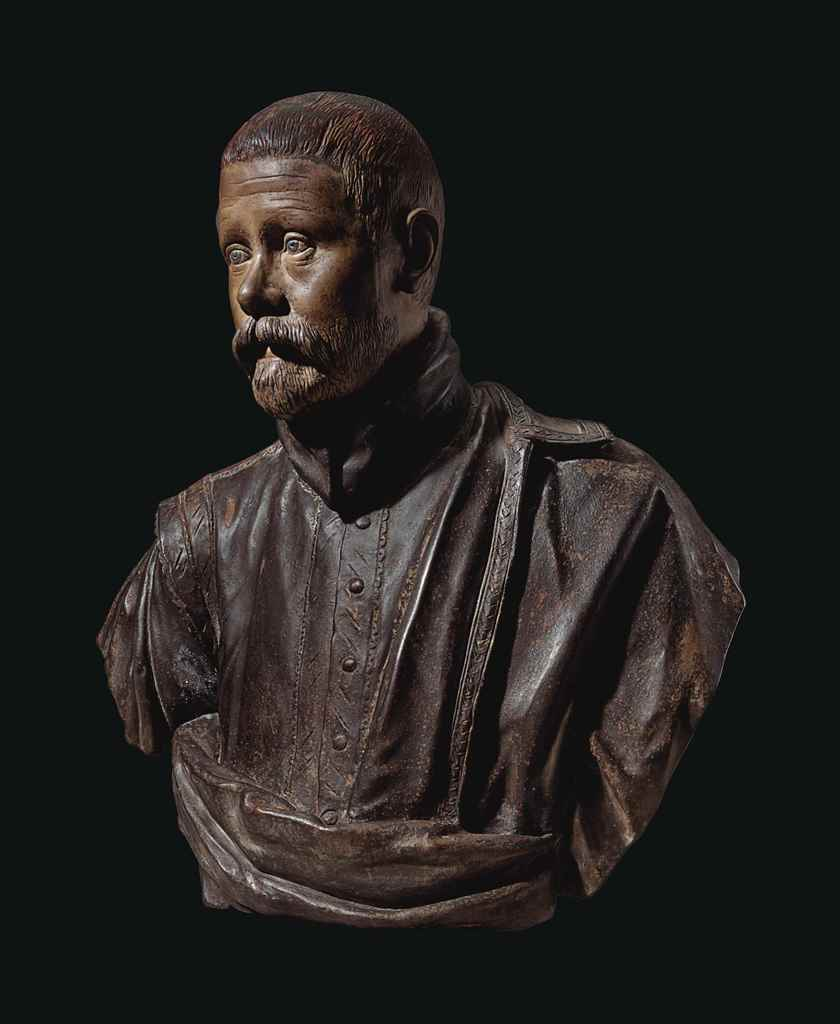 A TINTED TERRACOTTA BUST OF PA