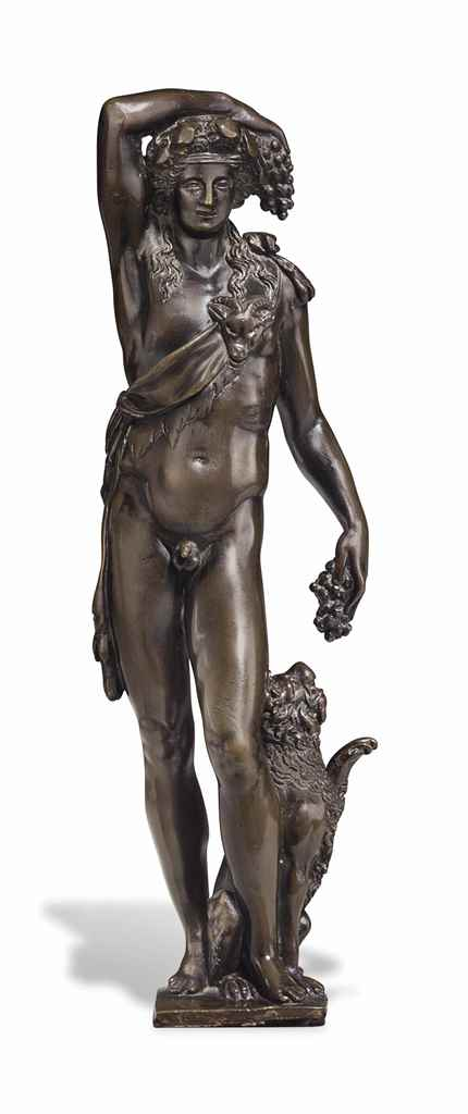 A BRONZE FIGURE OF BACCHUS WIT