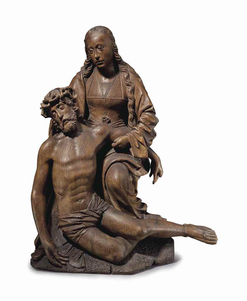 A CARVED OAK GROUP OF A PIETA