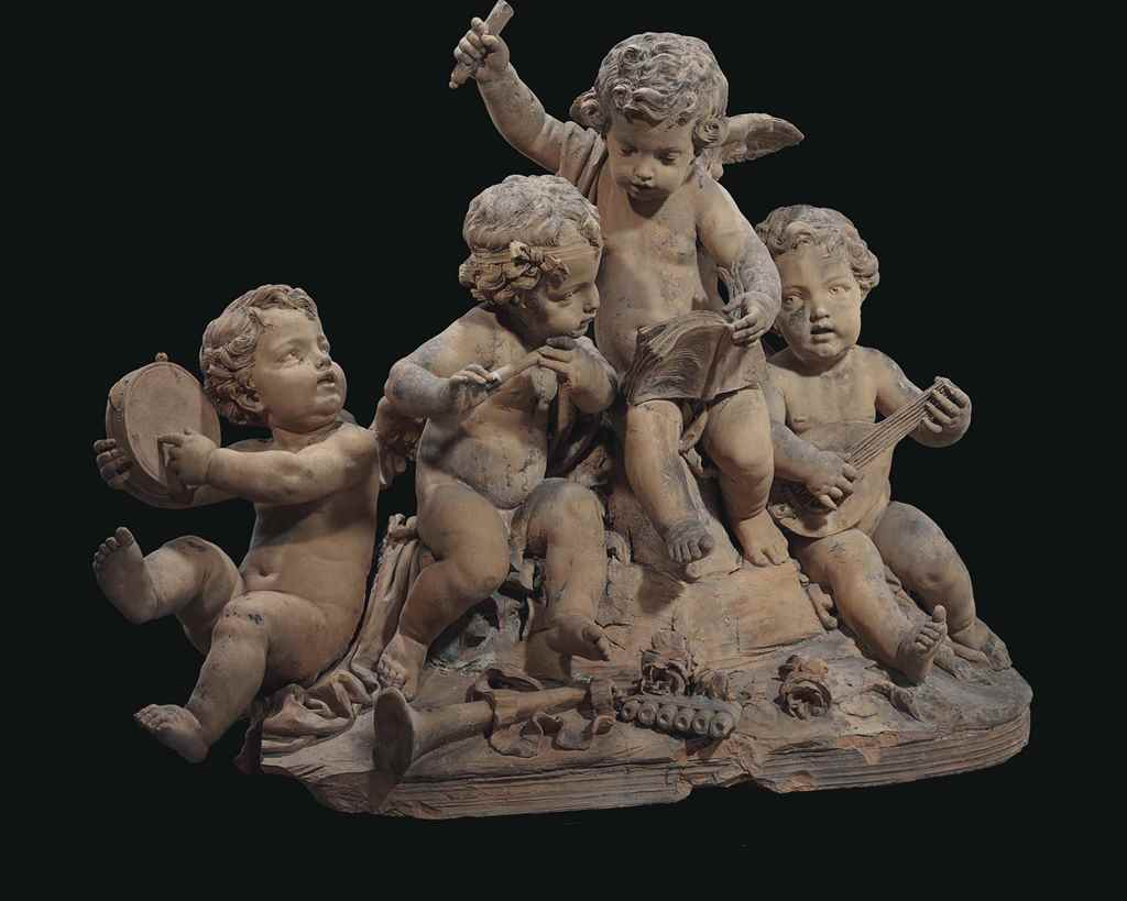 A TERRACOTTA GROUP OF FOUR PUT