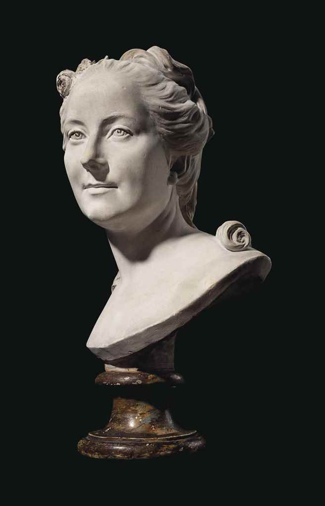 A WHITE PLASTER BUST OF MADAME