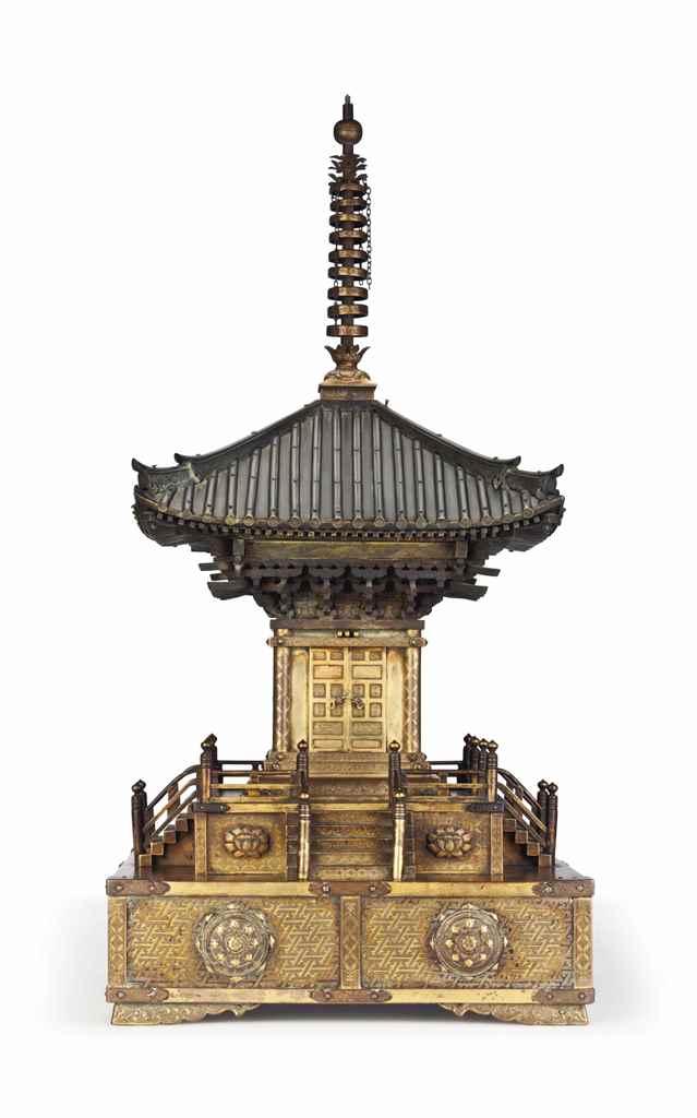 A gilt-bronze reliquary pagoda