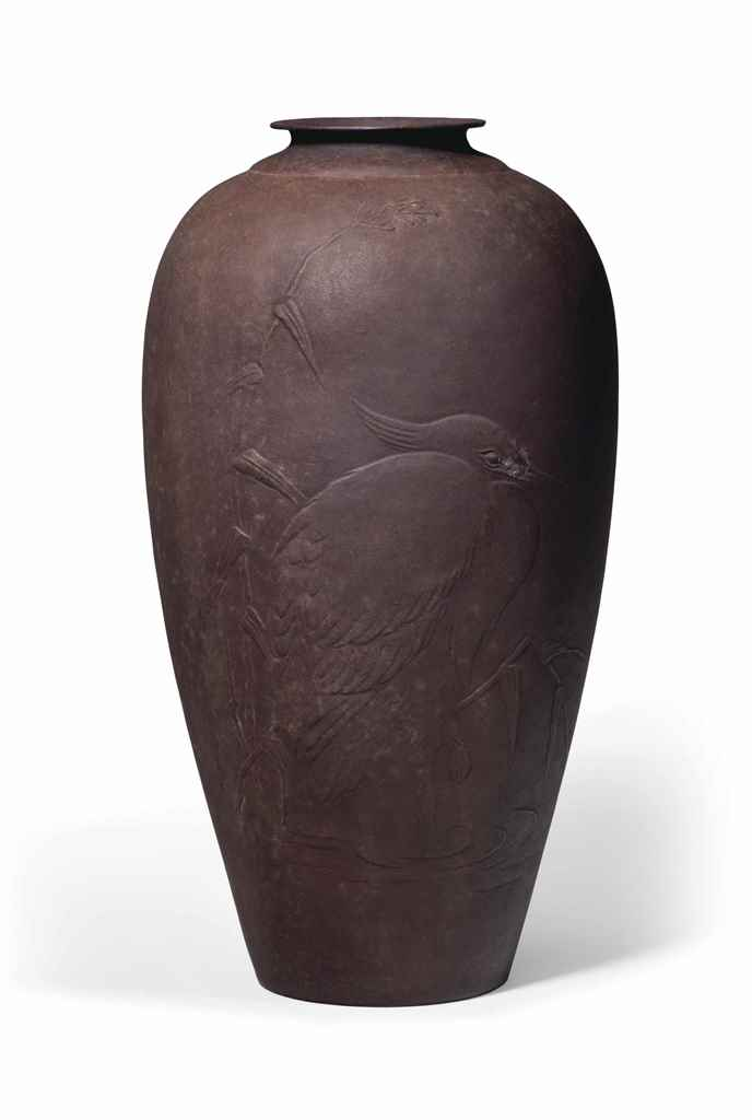 A hammered iron vase
