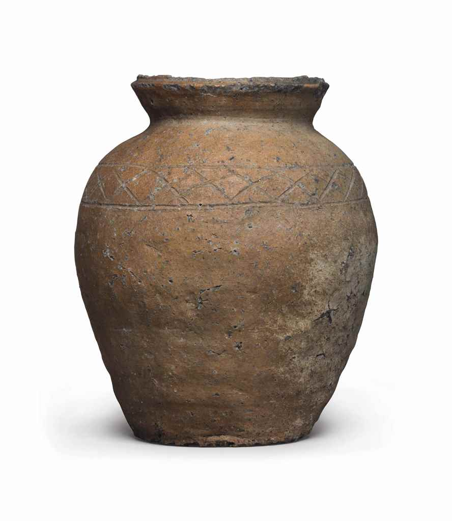 A small stoneware jar