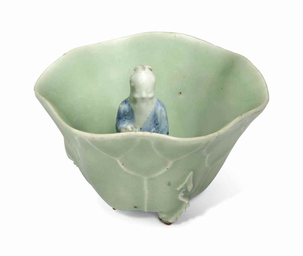 A CELADON-GLAZED 'LOTUS AND SH