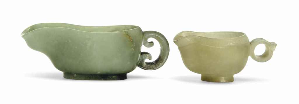 TWO CELADON JADE 'ARCHAISTIC'