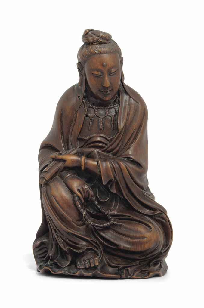 A CARVED SEATED BAMBOO FIGURE