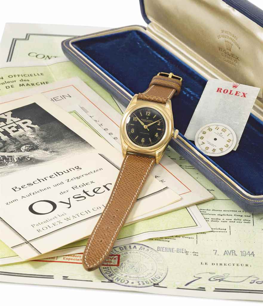 Rolex. A rare 18K gold and sta