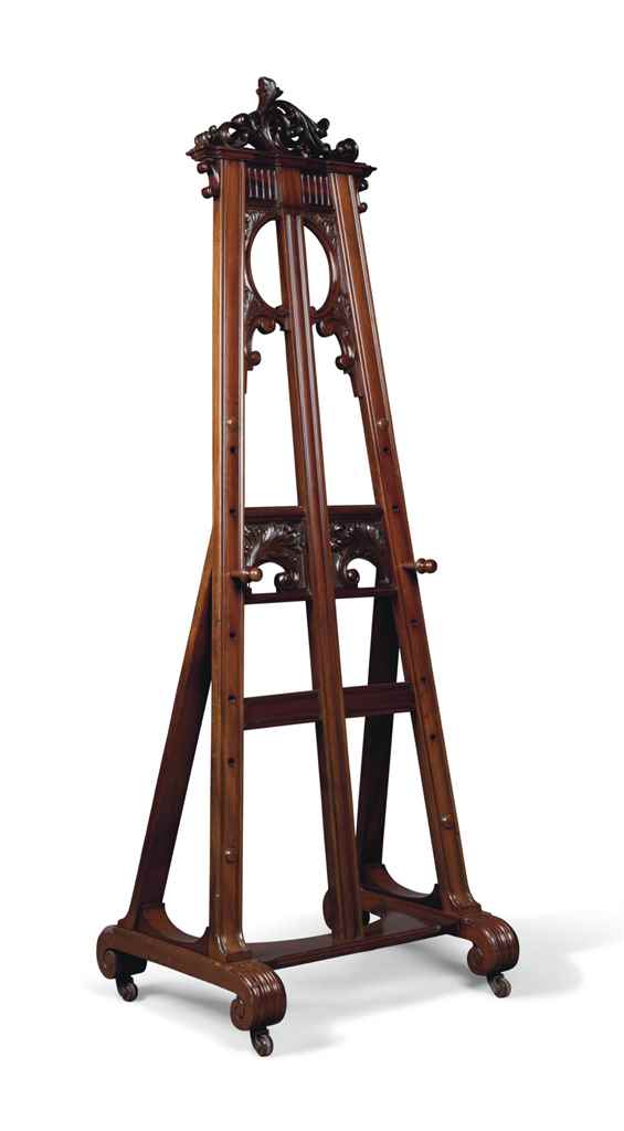 A CARVED MAHOGANY EASEL