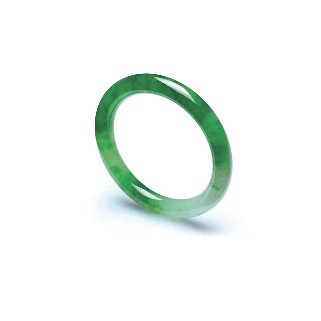 AN IMPRESSIVE JADEITE BANGLE