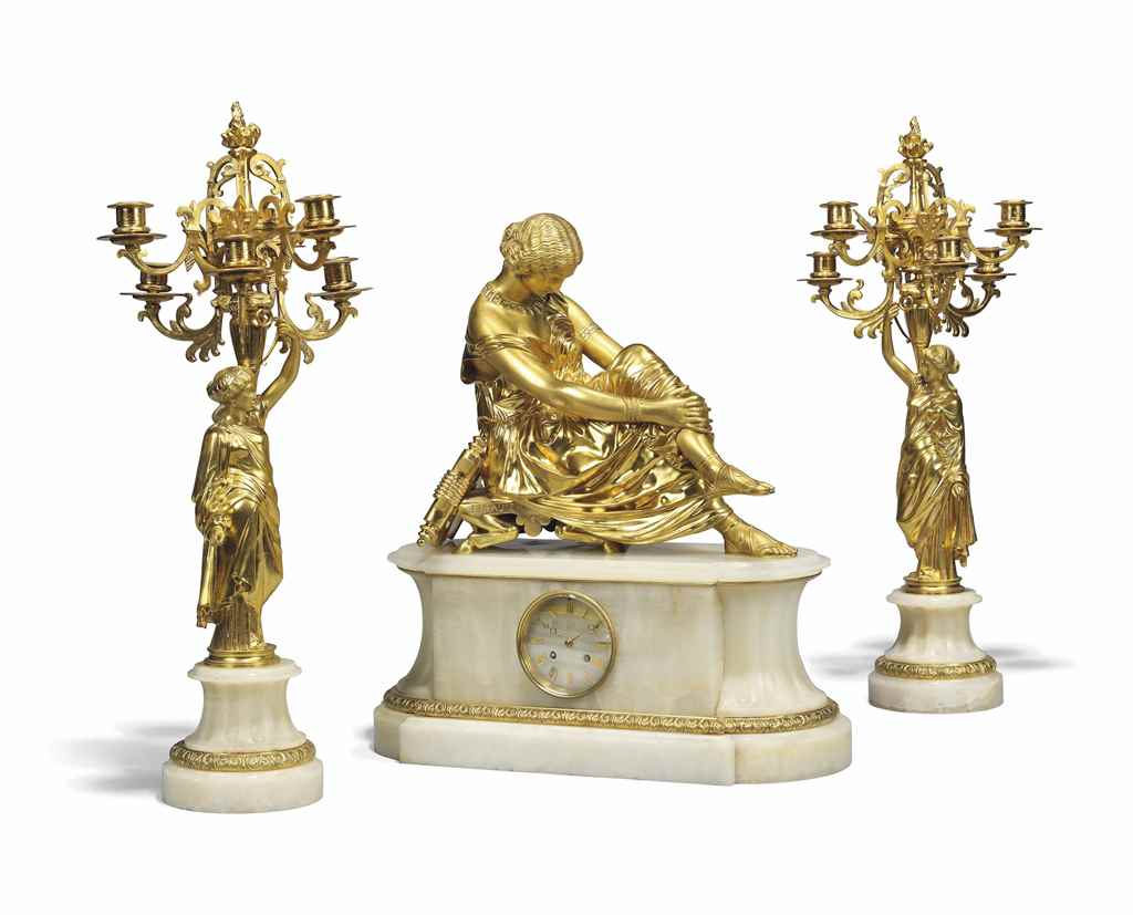 A FRENCH ORMOLU AND ONYX THREE