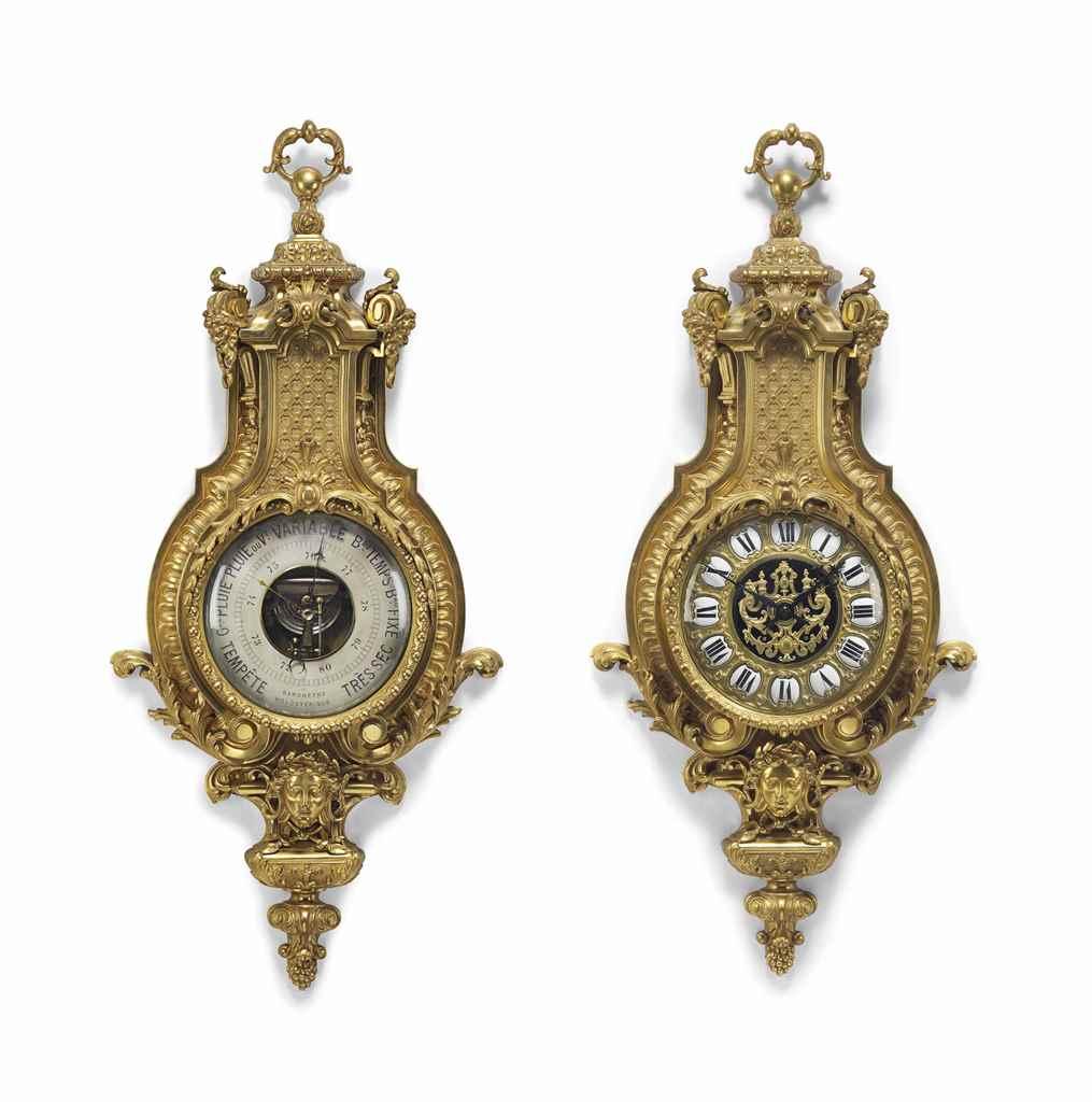 A FRENCH ORMOLU CARTEL CLOCK A