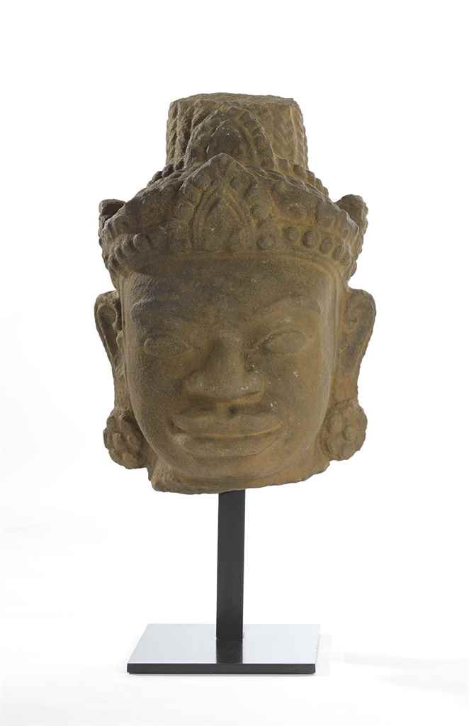 A STONE HEAD OF A DIVINITY