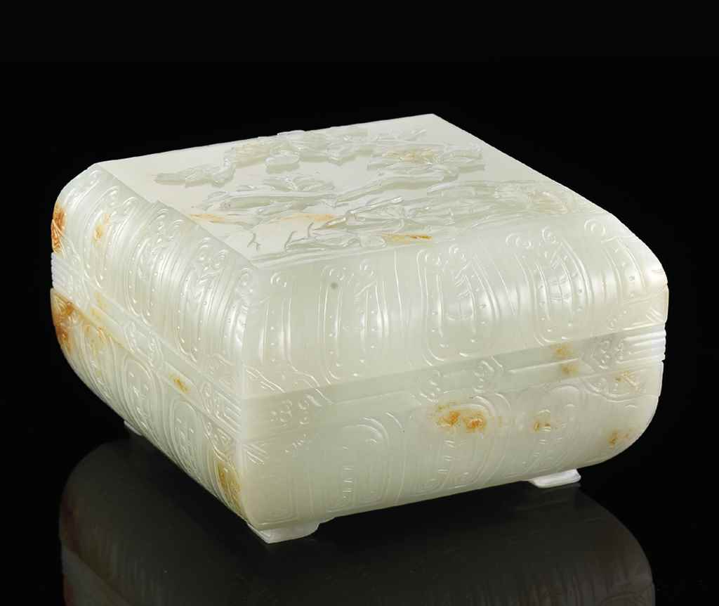 A RARE WHITE JADE THREE-TIERED
