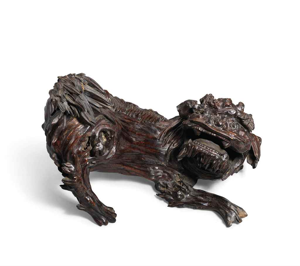 A CARVED ALOESWOOD FIGURE OF A