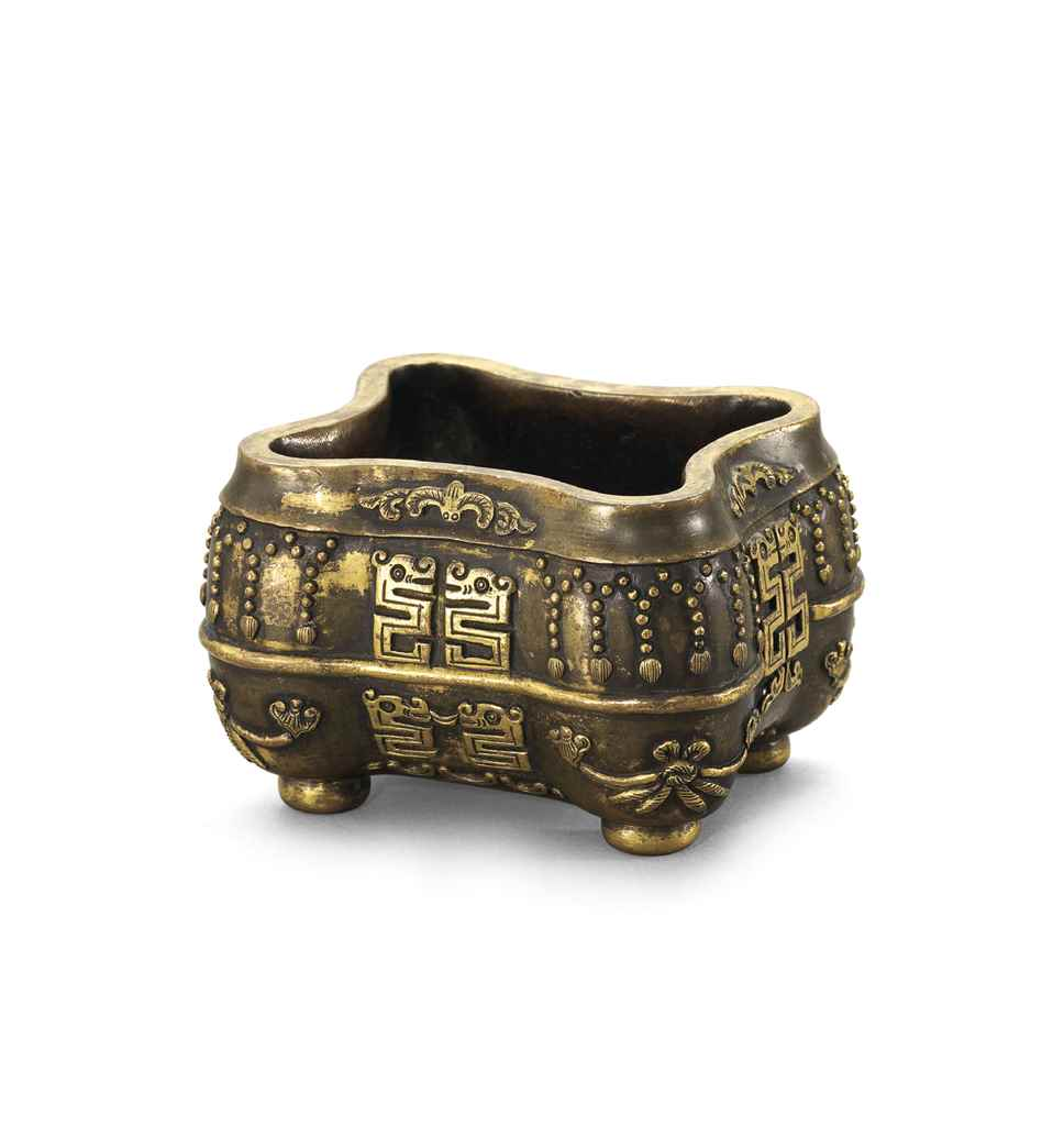 A PARCEL-GILT BRONZE INCENSE B