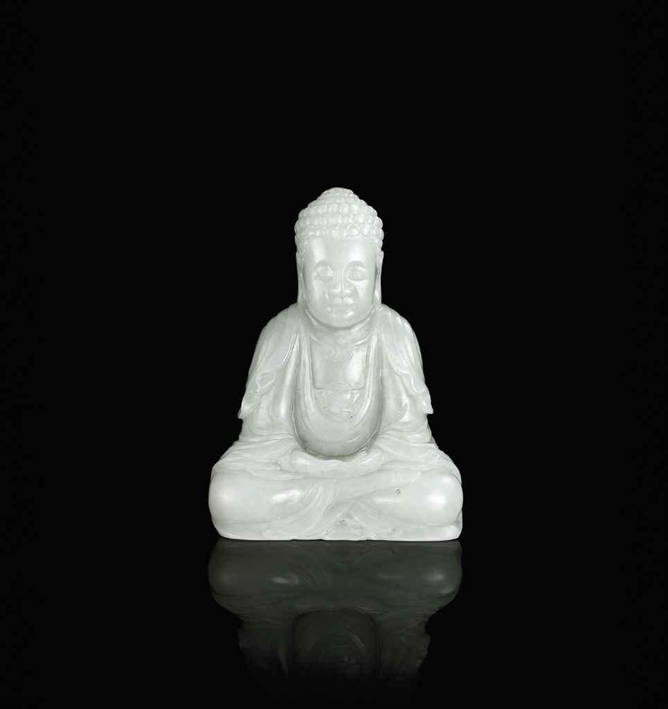 A WHITE JADE FIGURE OF A BUDDH
